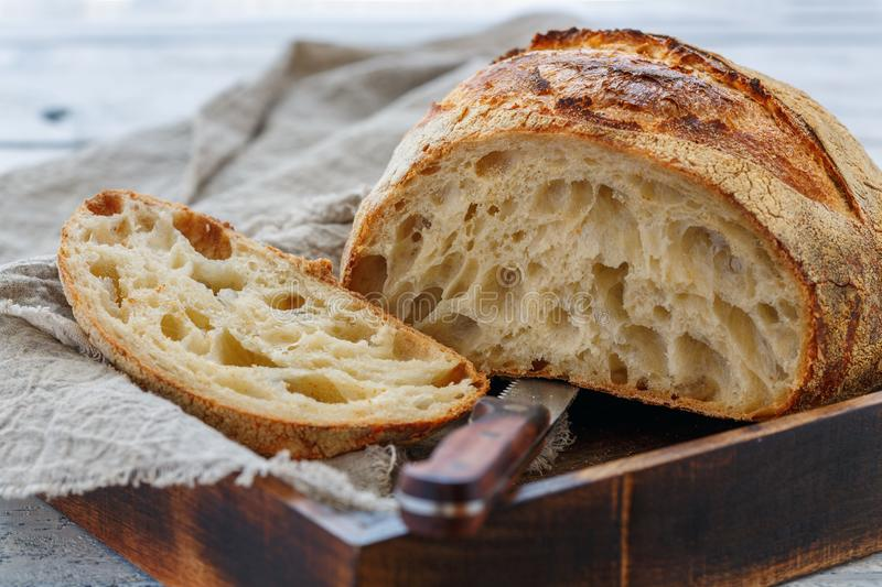 Cut loaf of artisanal wheat bread on sourdough. stock images