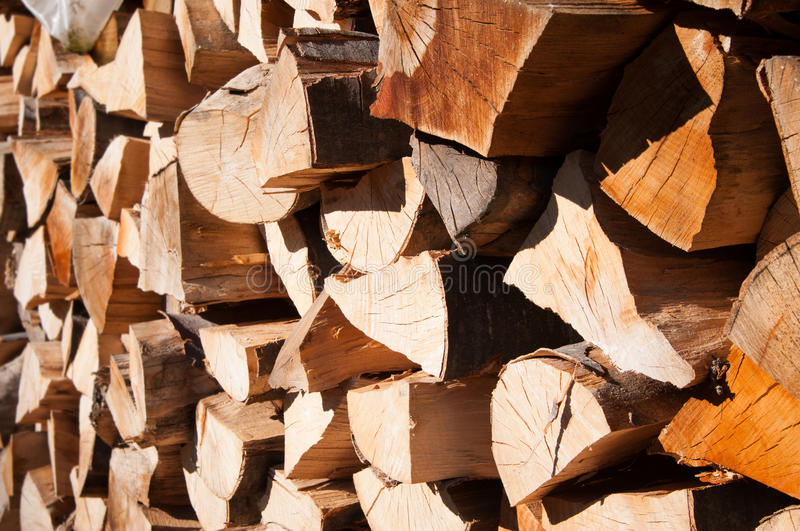 Cut logs. Wood logs cut for fire and stacked in a big pile in close up mode stock photography