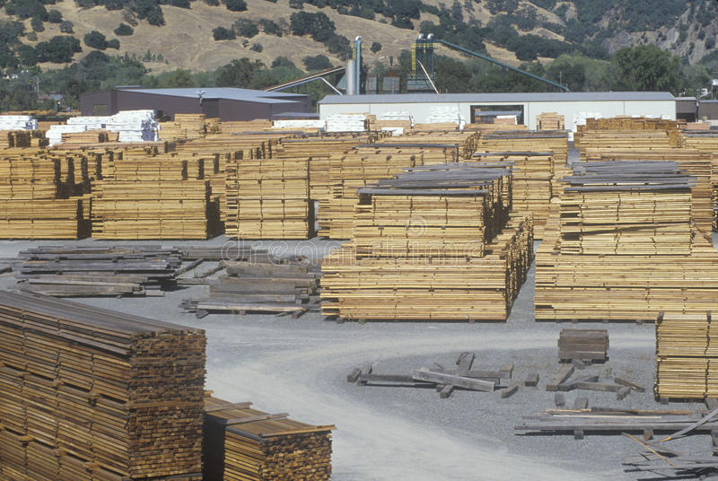 Cut lumber stacked stock images