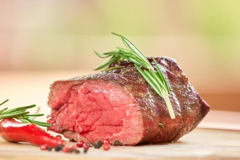 Cut off piece of cooked meat. Grilled meat on table stock photos