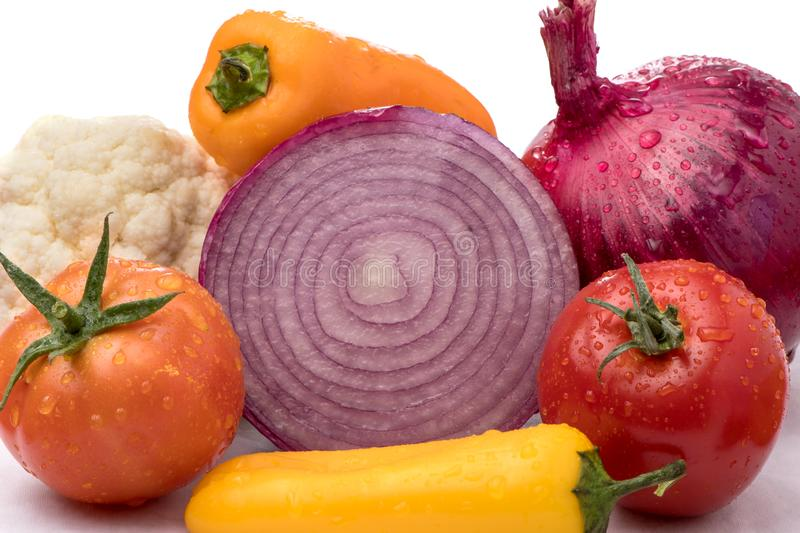 Cut onion and Vegetable Medley for salad with peppers, cauliflower, and tomatoes. Health concept. Water Droplets royalty free stock photo