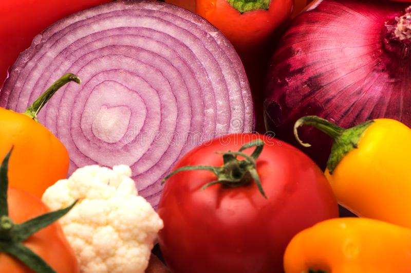 Cut onion and Vegetable Medley for salad with peppers and tomato stock photo