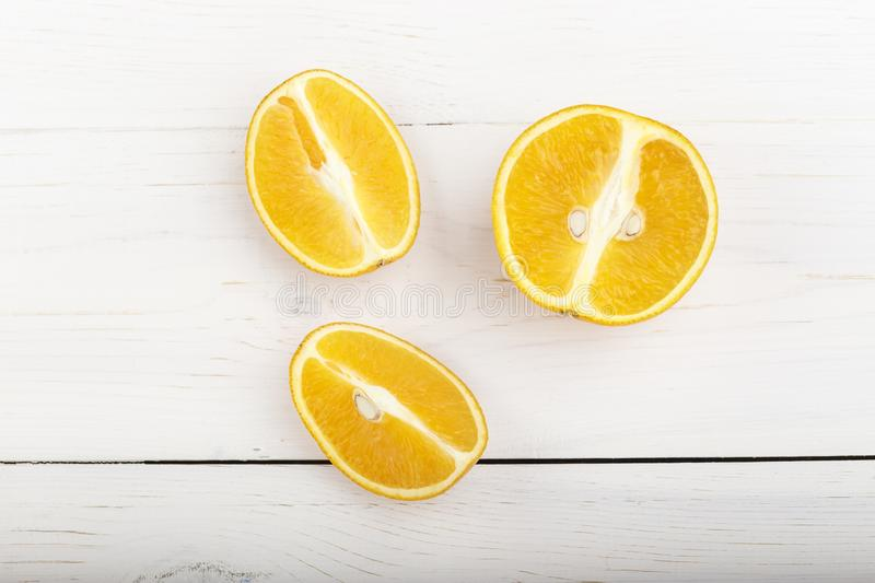 Cut oranges on the table. Fresh cut oranges for juice. vitamin drink to enhance immunity stock photography