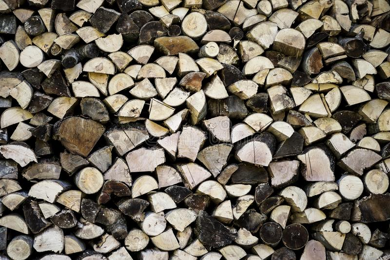 Cut and ordered logs of wood, frontally photographed. The wood is cut precisely and placed in a precise way, leaving it perfectly ordered stock image