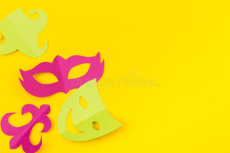 Cut out colored paper figures for the holiday Mardi Gras, colour background. stock photos