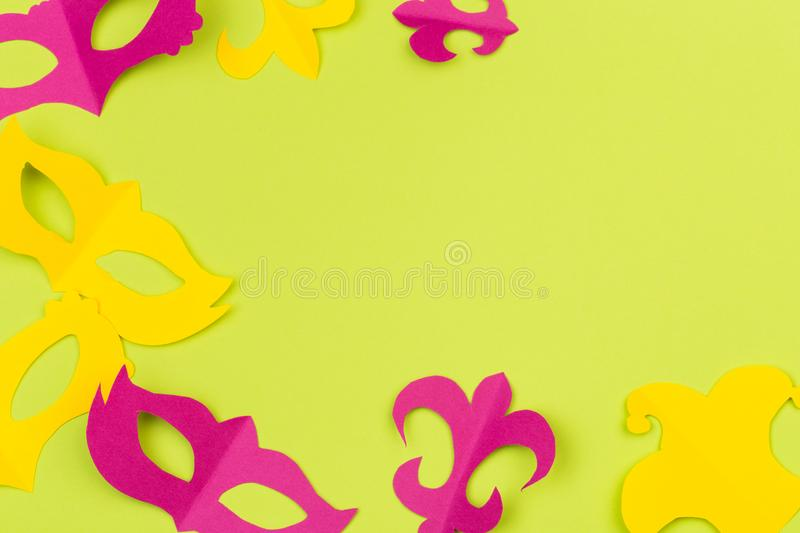 Cut out colored paper figures for the holiday Mardi Gras, colour background.  stock image