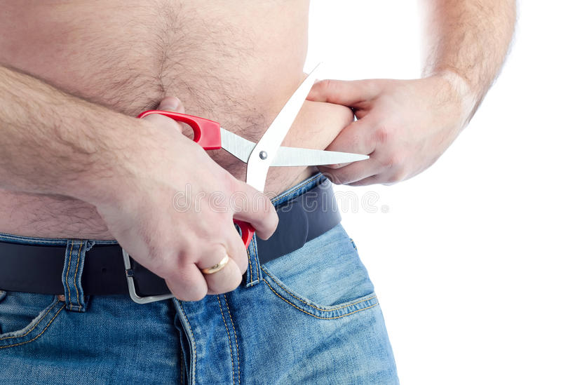 Cut out the fat. Man try to cut out fat stomach skin royalty free stock photos