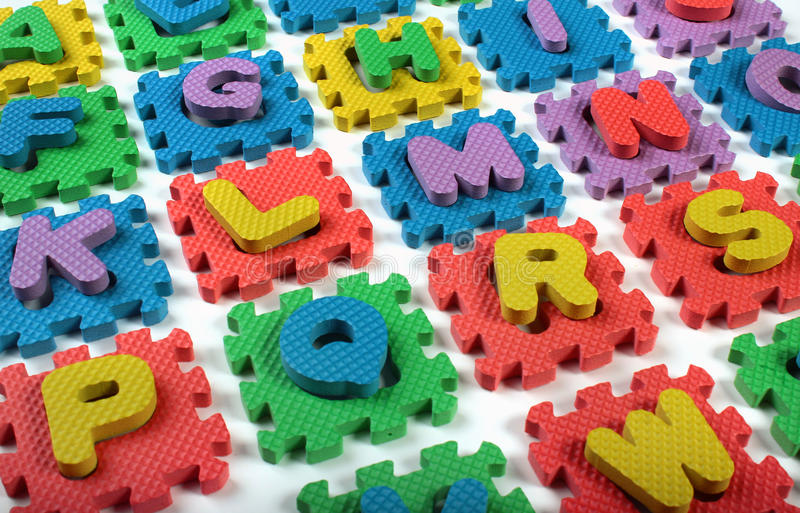 Cut out letters of toy plastic alphabet.  royalty free stock images
