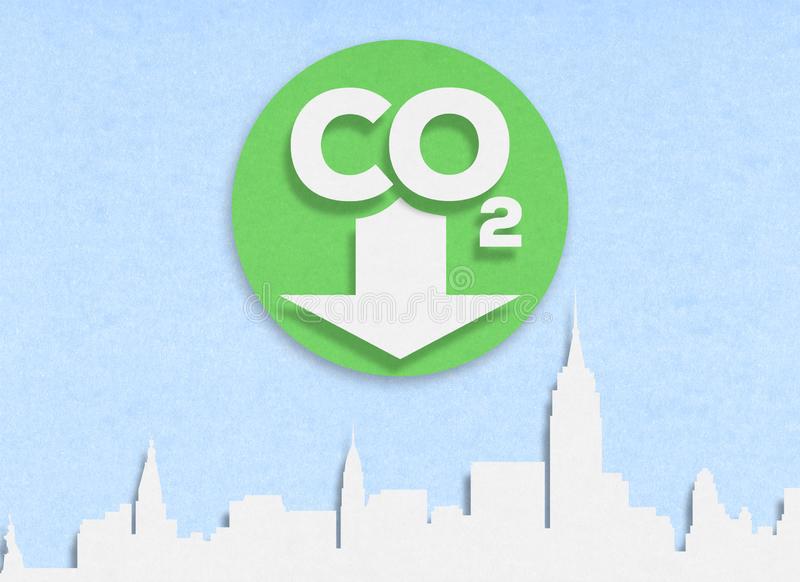 Cut out low emission zone on cardboard. Carbon Dioxide. CO2 logo on a white cardboard and city skyline royalty free stock photos