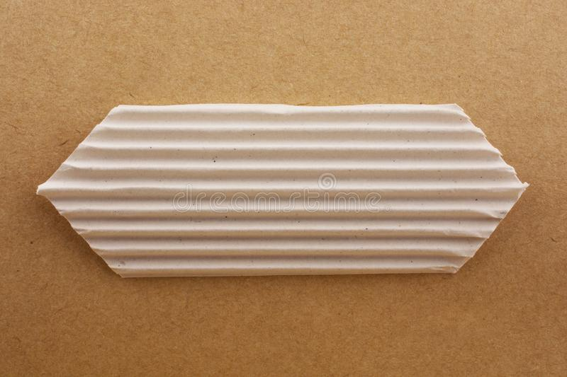Cut out paper with pattern. On a brown background royalty free stock photo