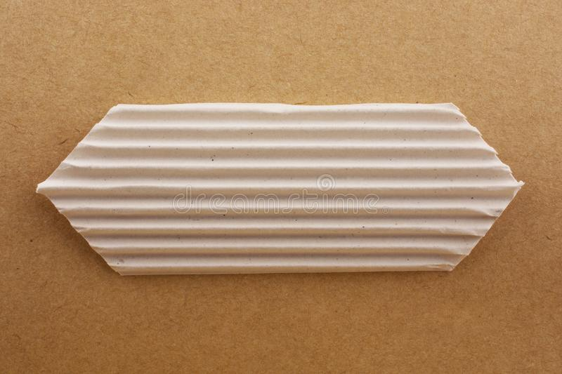 Cut out paper with pattern. On a brown background royalty free stock photography