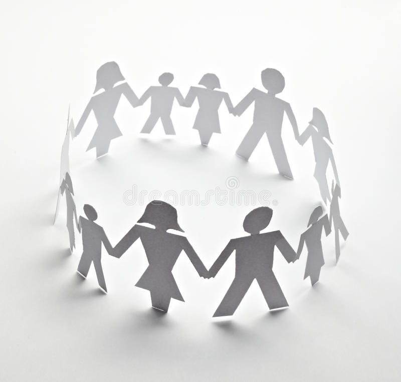 Cut out paper people. Close up of people cut out of paper on white background stock image