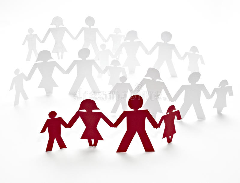 Cut out paper people. Close up of people cut out of paper on white background royalty free stock image