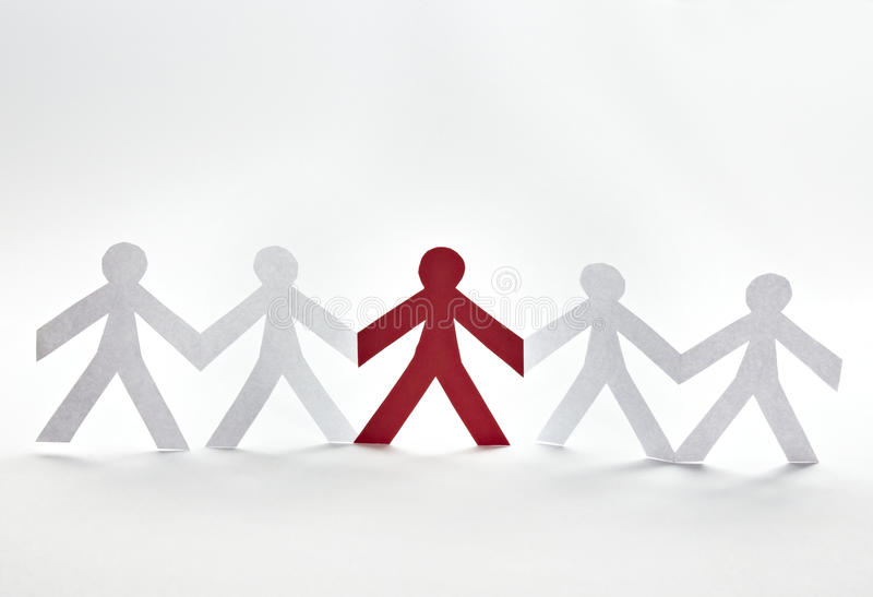 Cut out paper people. Close up of people cut out of paper on white background royalty free stock images