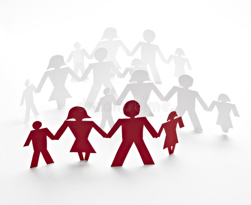Cut out paper people. Close up of people cut out of paper on white background royalty free stock photography