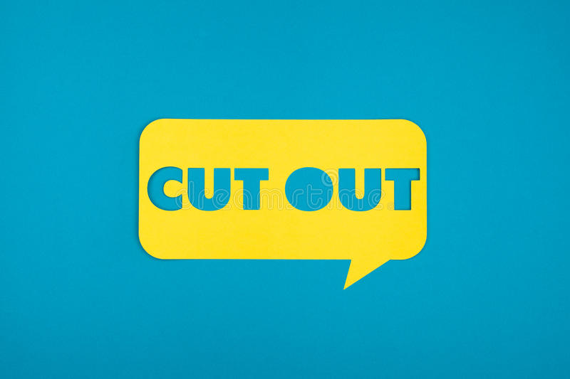 The cut out paper word. The cut out words in yellow bubble on the blue background stock photos