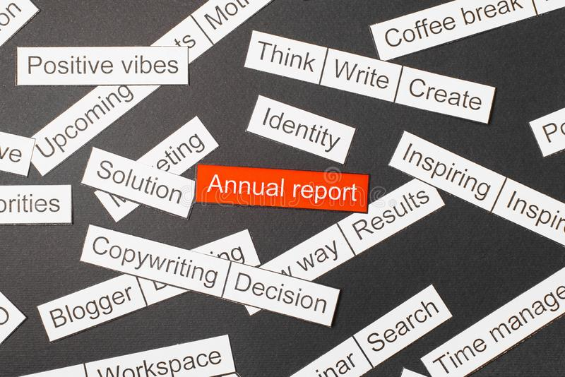 Cut paper inscription annual report on a red background, surrounded by other inscriptions on a dark background. Word cloud concept.  royalty free stock image