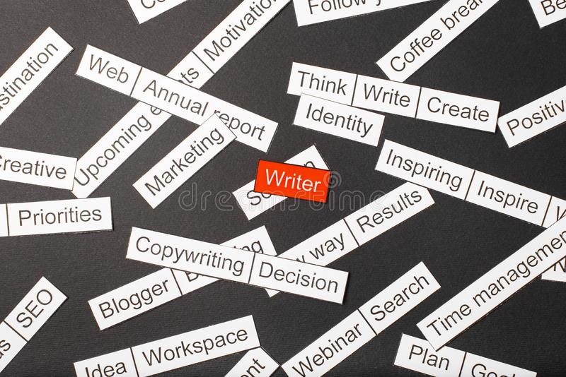 Cut paper inscription writer on a red background, surrounded by other inscriptions on a dark background. Word cloud concept stock images