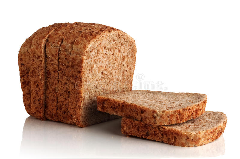 Bread from sprouted grains. Cut into pieces a loaf of bread from sprouted grains on a white background royalty free stock image