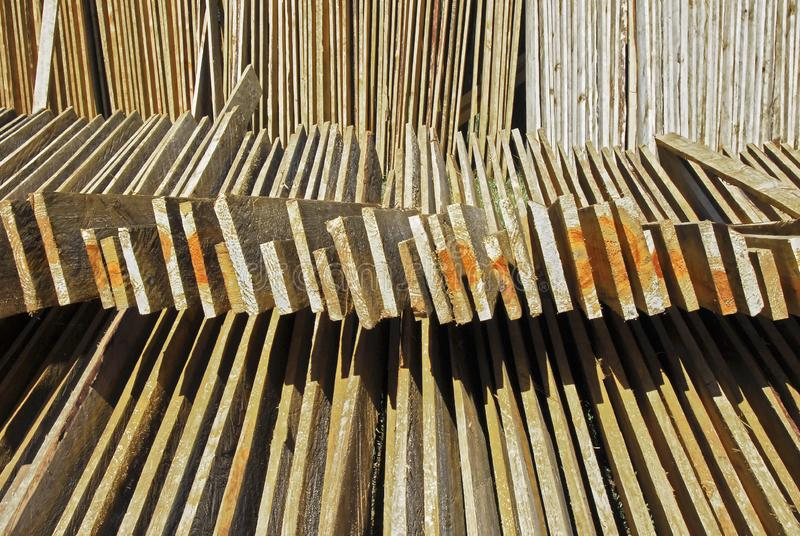 Cut Pine wood panels for drying. Cut and marked pine wood planks layed-out for drying in the sun, seen near Sagada Town, Mountain Province, Philippines royalty free stock photography