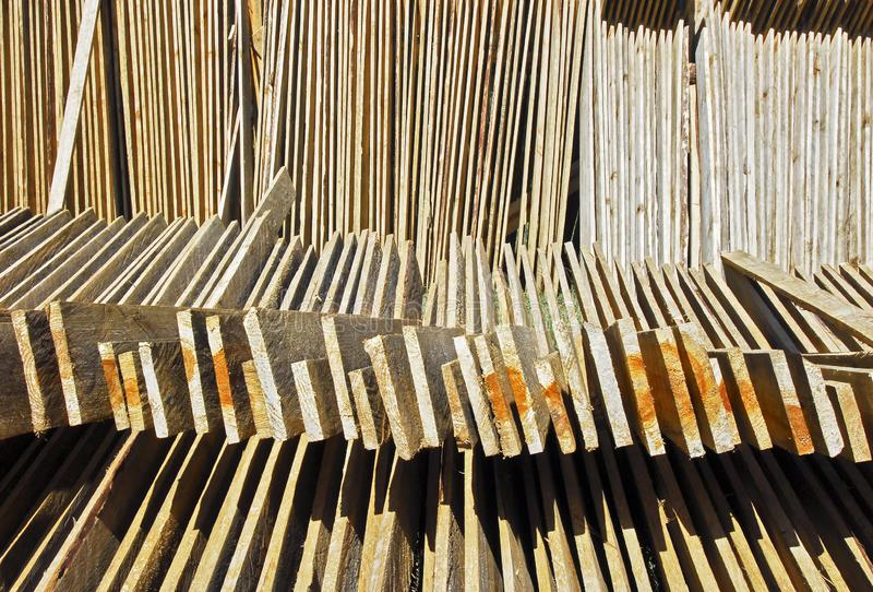Cut Pine wood panels for drying. Cut and marked pine wood planks layed-out for drying in the sun, seen near Sagada Town, Mountain Province, Philippines stock photo