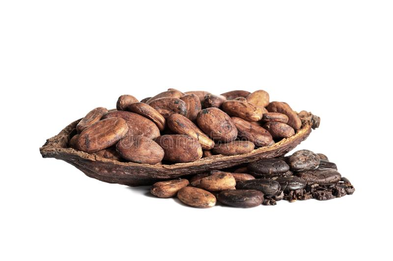 Cut pod and cocoa beans isolated. On white stock photography