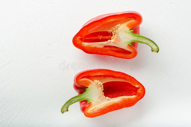 Cut red bell peppers. Into two pieces on white background stock images