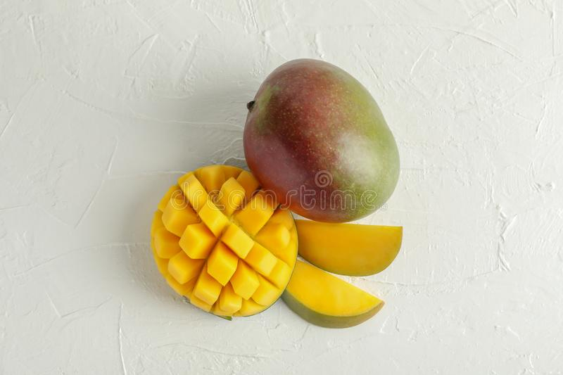 Cut ripe mangoes and space for text on white background royalty free stock photo
