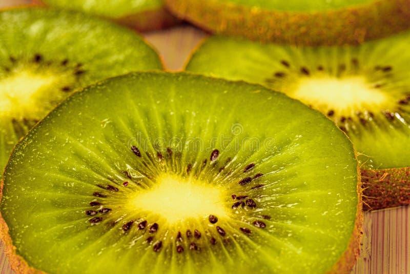 Cut slices of kiwi fruit. Close-up. Selective focus stock photo