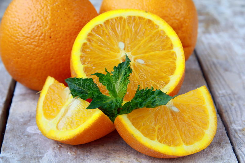 Cut into slices and whole oranges royalty free stock photography