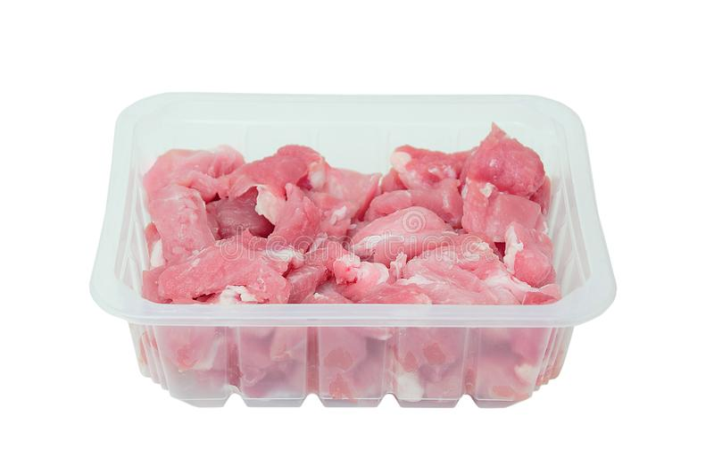Cut into small pieces of raw pork meat in plastic packaging. stock photos