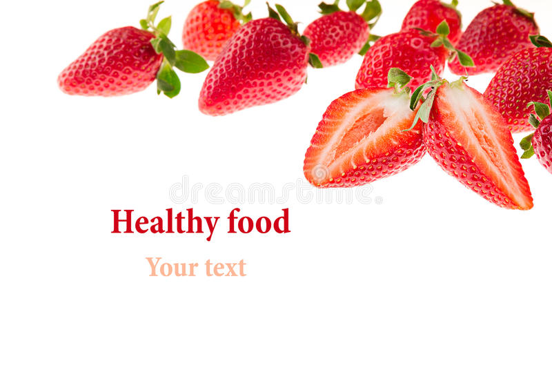 Cut strawberries with strawberry pattern. Isolated. Macro. Texture. Frame with copy space. Food background stock photography