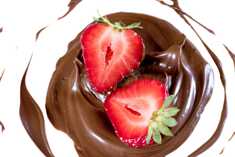 Cut strawberry in chocolate stock photography
