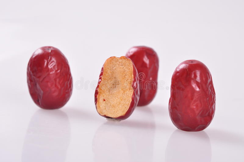 Cut surface-Red jujubes. Red jujube, also called chinese date, is a traditional chinese food. it is commonly used in desserts、sweet soup、porridge royalty free stock photography