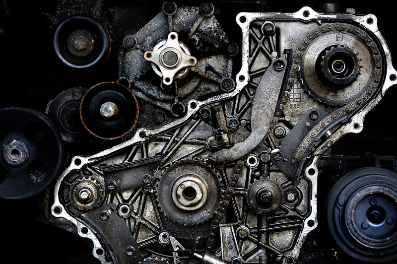 Cut thrue engine. Cut thrue car engine cogwheel stock photo