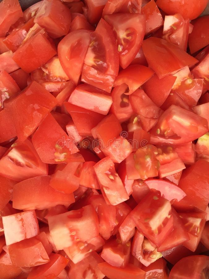 Cut tomatoes. Diced red tomato covering the full frame stock images