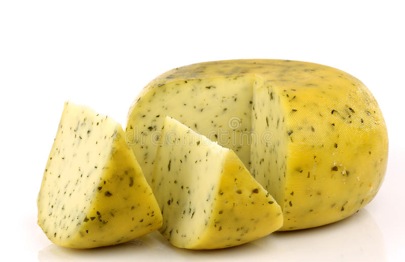 Cut traditional Gouda cheese with herbs