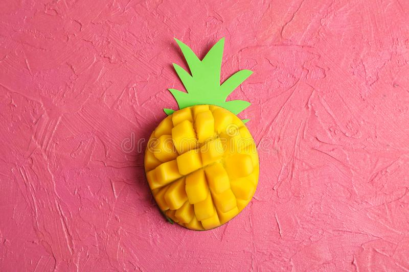 Cut tropical ripe mango on color background. Top view stock image