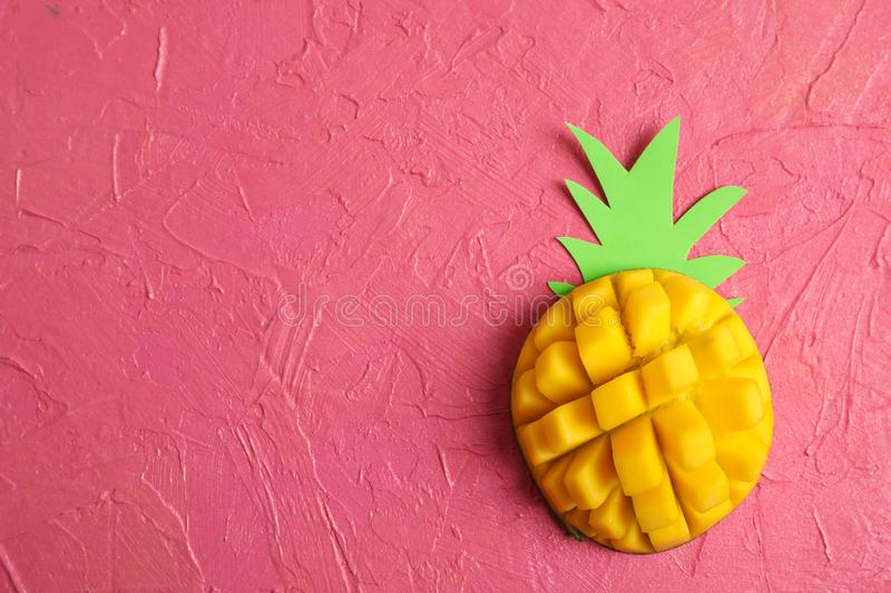 Cut tropical ripe mango and space for text on color background. Top view stock photo