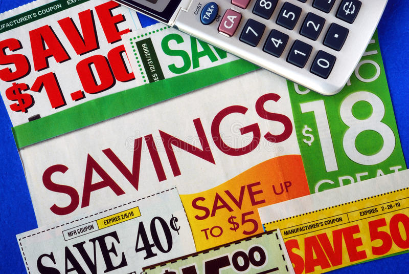 Cut up some coupons. To save money royalty free stock photography