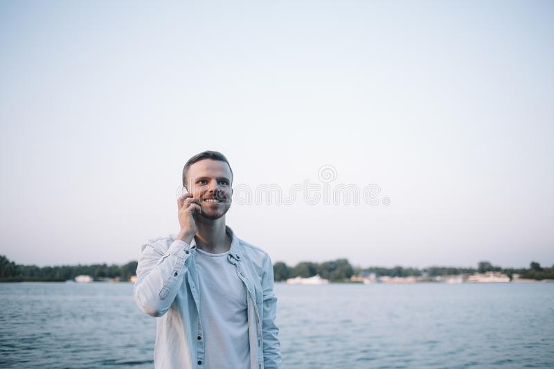 A guy with a phone in park stock photos