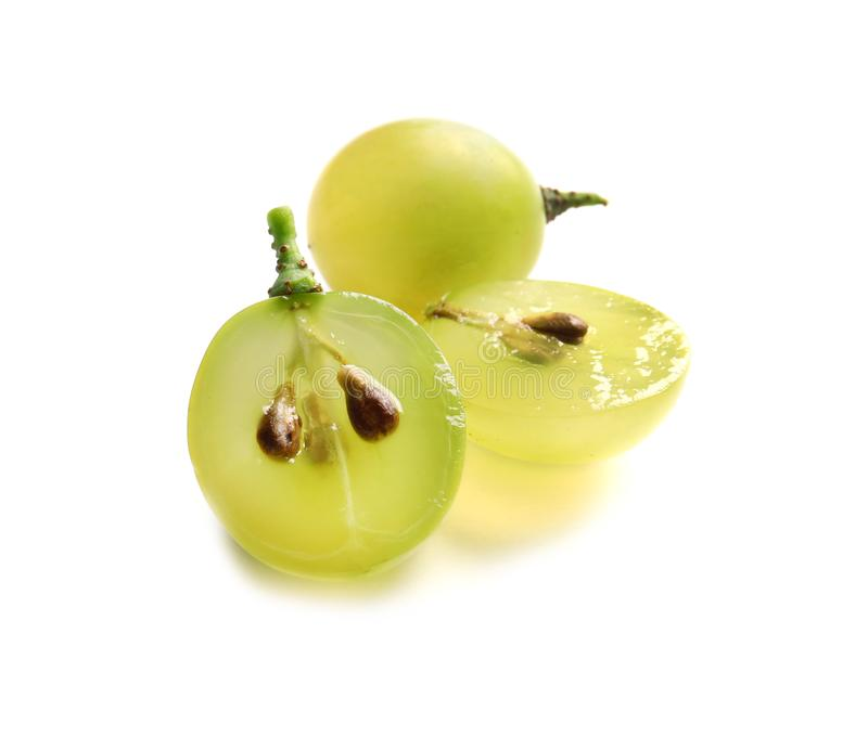 Cut and whole fresh ripe juicy grapes with seeds. On white background stock photography
