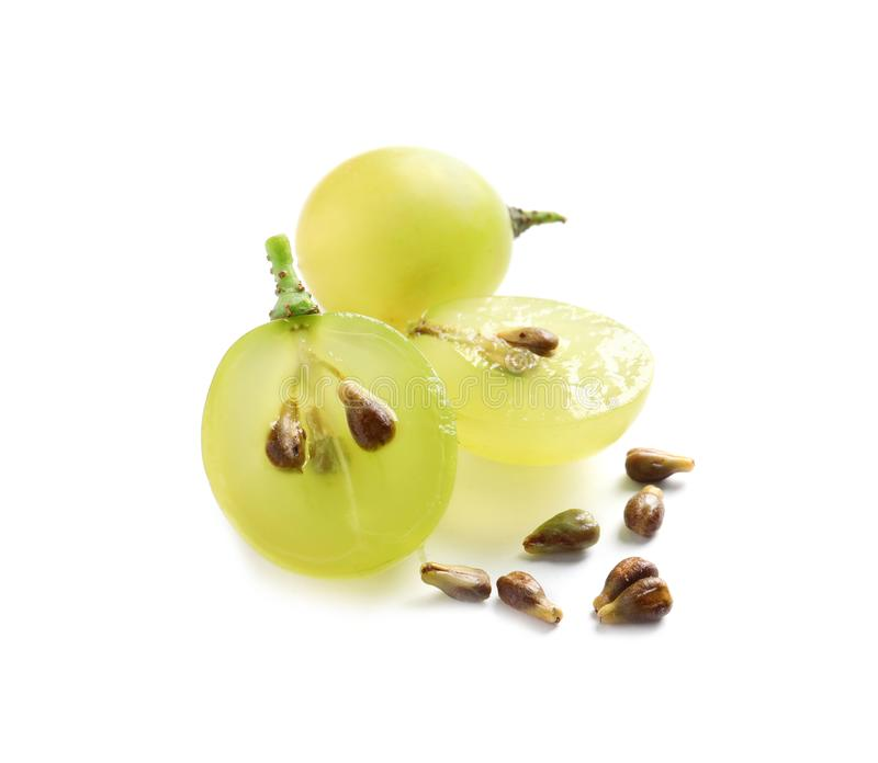 Cut and whole fresh ripe juicy grapes with seeds. On white background royalty free stock image