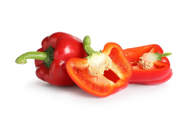 Cut and whole ripe red bell peppers. On white background stock image
