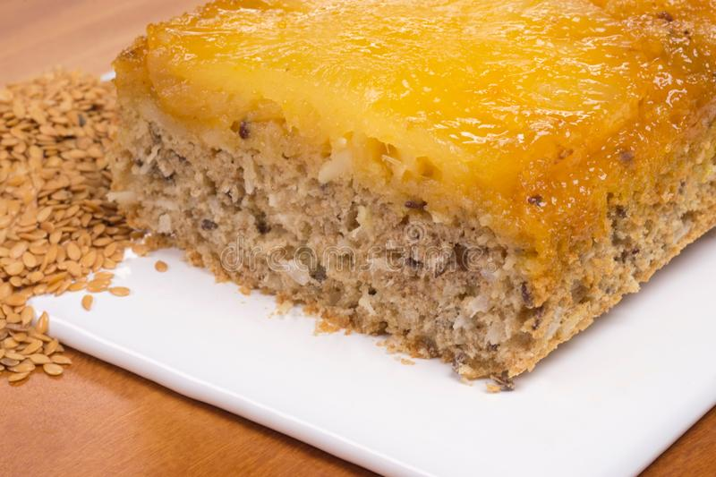 Cut Wholemeal pineapple cake with linseed and golden linseed close stock images