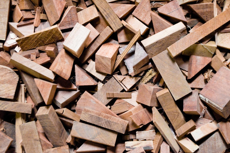 Cut wood pieces background texture. Cut wood pieces remaining from carpenter handcraft. They are piled up waiting for reuse as smaller material required. They stock photo