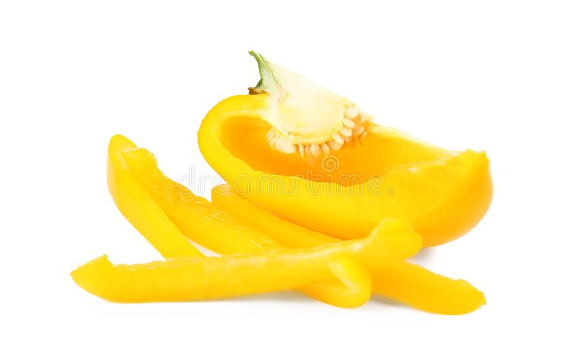 Cut yellow bell pepper on white. Cut yellow bell pepper isolated on white royalty free stock images