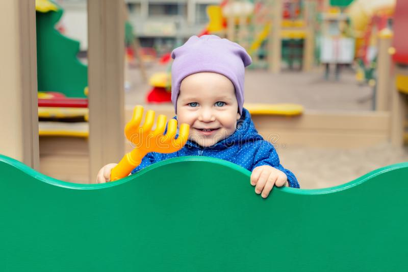 Cute adorable caucasian toddler boy enjoy having fun at outdoor playground. Portrait of happy little child playing ouside royalty free stock image