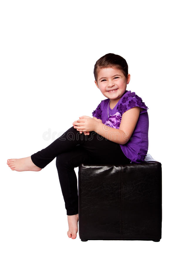 Cute adorable girl sitting stock photos