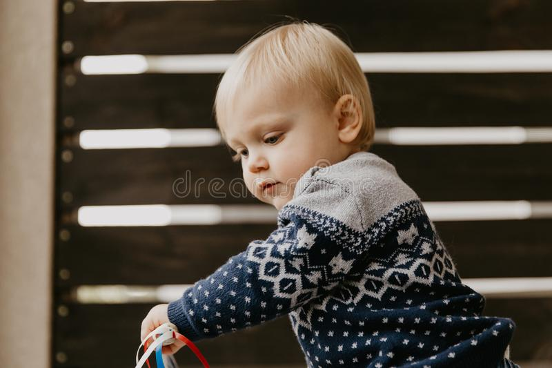 Cute Adorable Little Blonde Toddler Kid Laughing, Having Fun, and Making Silly Faces Outside at Home on the Patio Screened Porch. Outside royalty free stock photography